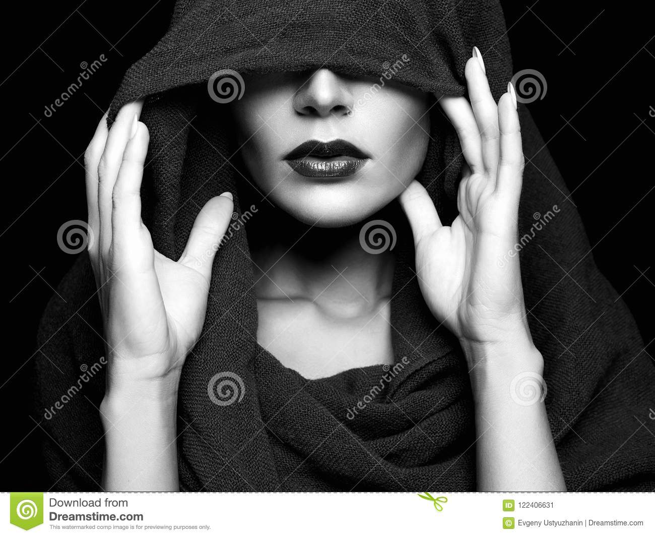 fa730aae8f0 Beautiful woman covers her face under hood. part of female face. Black and  white portrait