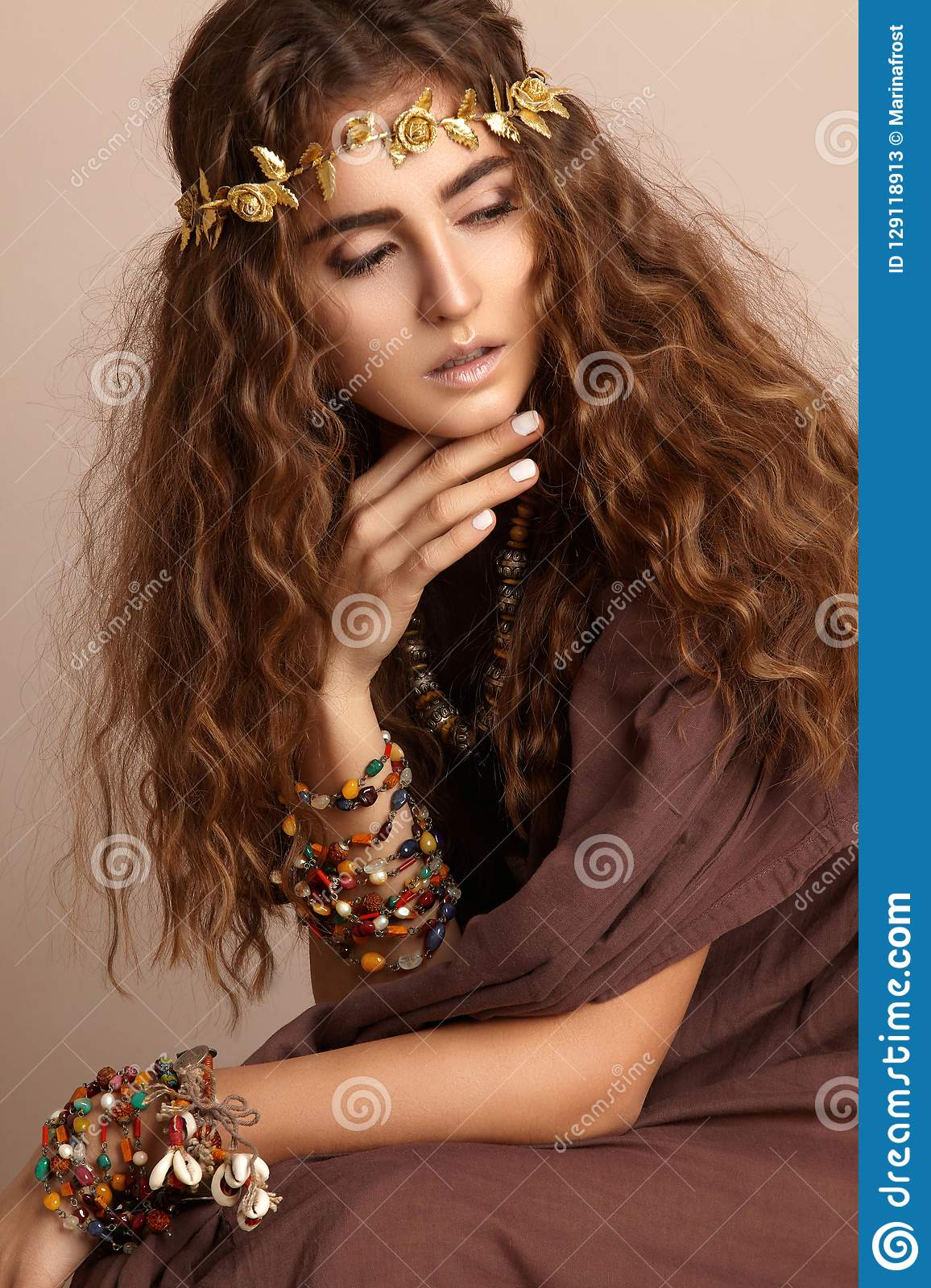 Beautiful Woman. Curly Long Hair. Fashion Model. Healthy Wavy Hairstyle. Accessories. Autumn Wreath, Gold Floral Crown