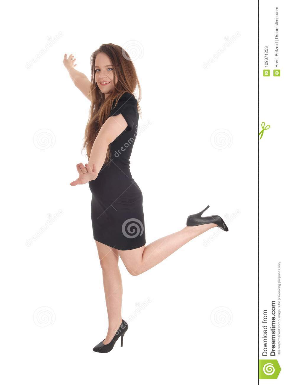 Beautiful woman dancing in a black dress
