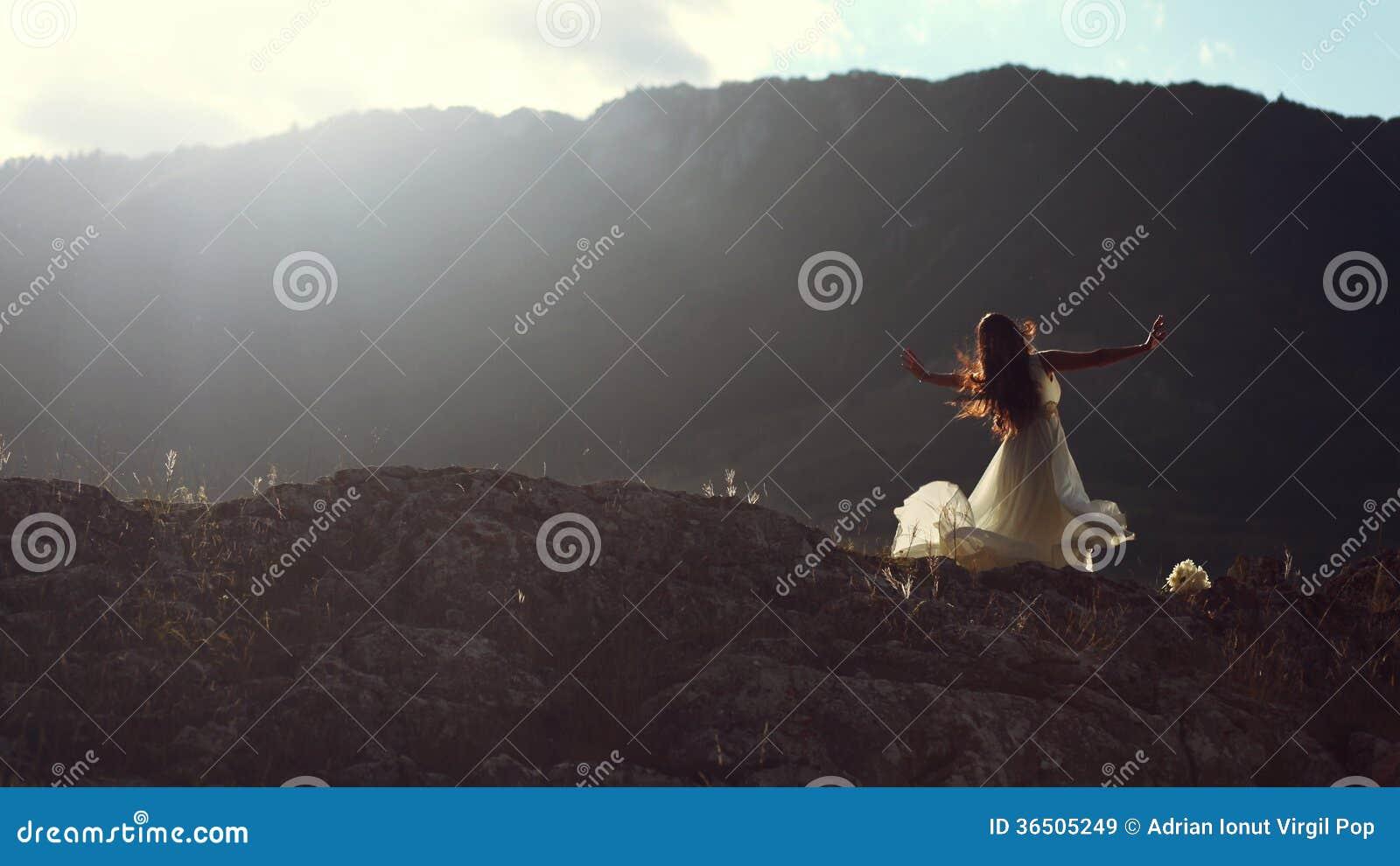 Beautiful woman dancing in evening light