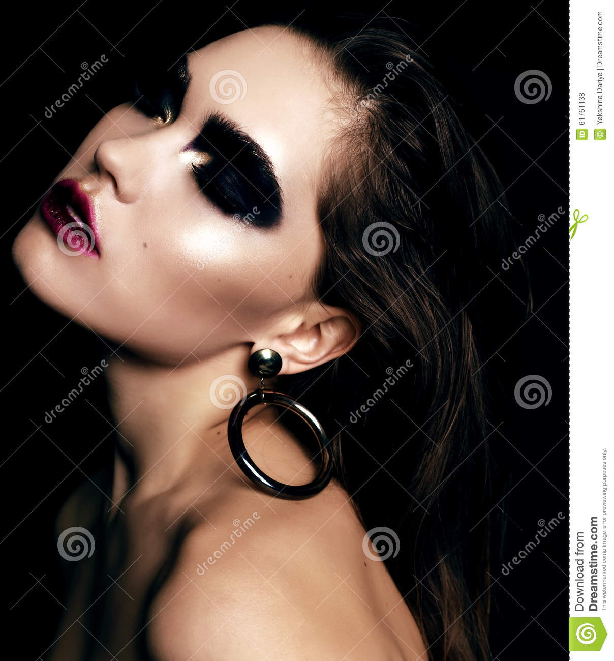 Beautiful Woman With Dark Hair And Extravagant Black Smokey Eyes