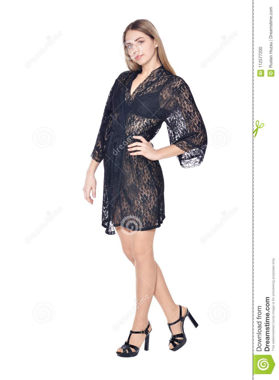 ecc51bc313c Portrait of beautiful woman in dark lace dressing gown posing isolated on white  background