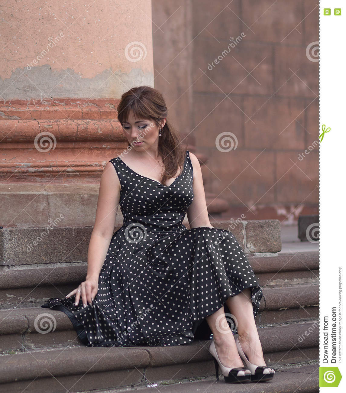 Beautiful woman dressed in retro style