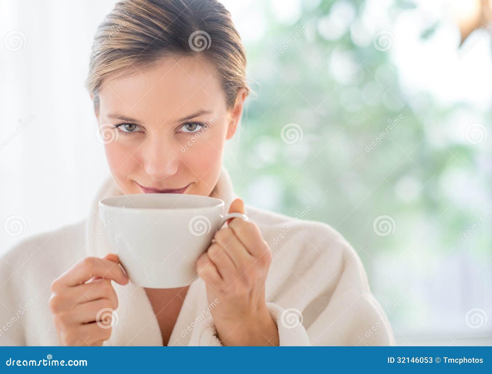 Beautiful Woman Drinking Coffee In Health Spa