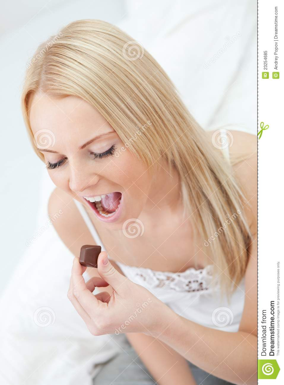 Beautiful Eat In Kitchens: Beautiful Woman Eating Chocolate Royalty Free Stock Photo
