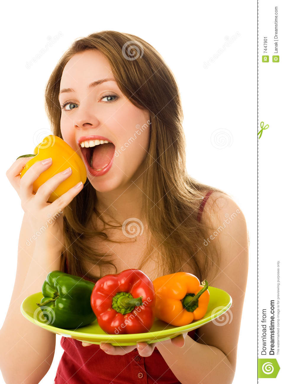 Beautiful Eat In Kitchens: Beautiful Woman Eating Peppers Stock Image