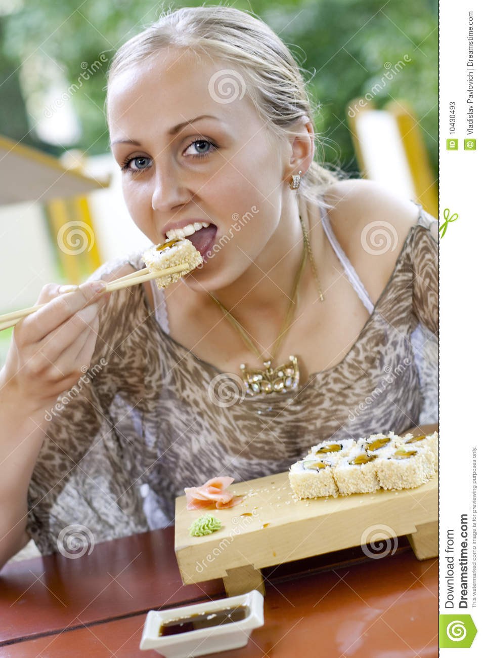 Beautiful Eat In Kitchens: Beautiful Woman Eating Sushi. Stock Photos