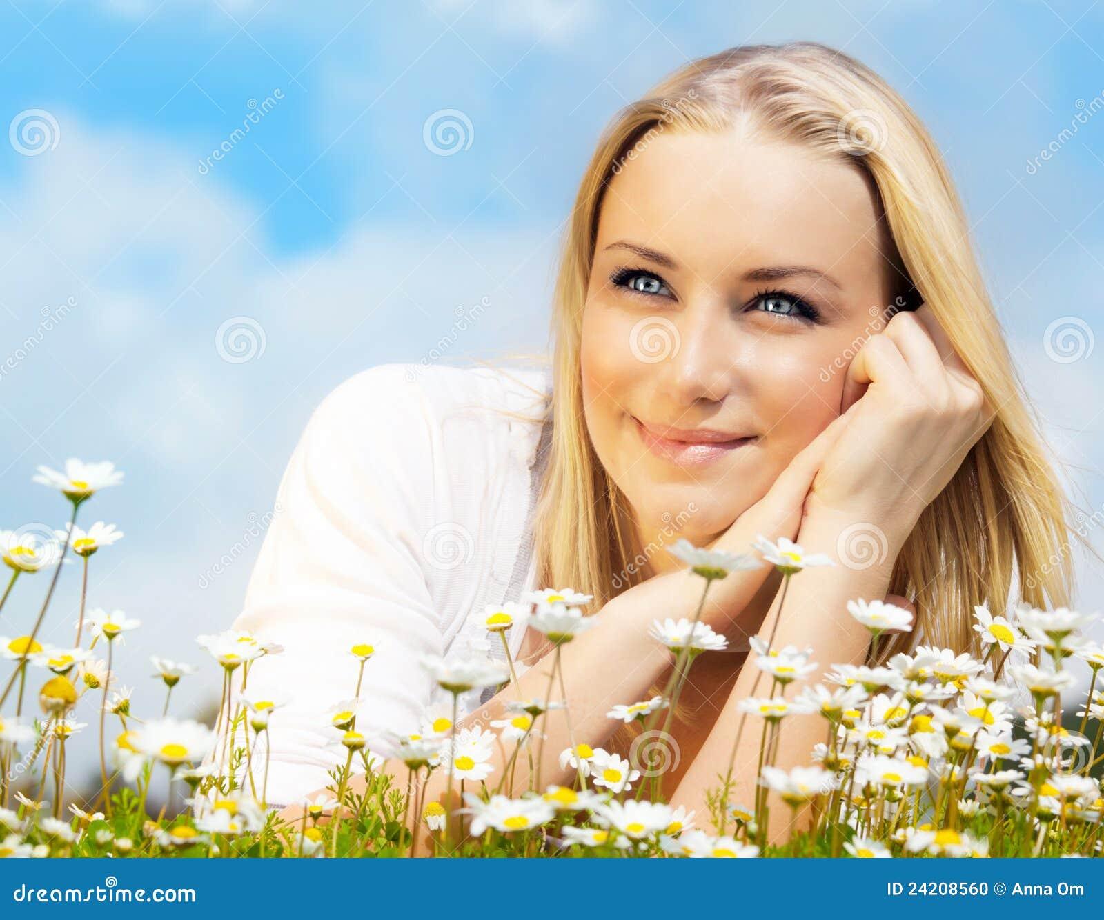 Happy Beautiful Woman Enjoying At Beach Stock Photo: Beautiful Woman Enjoying Daisy Field And Blue Sky Stock