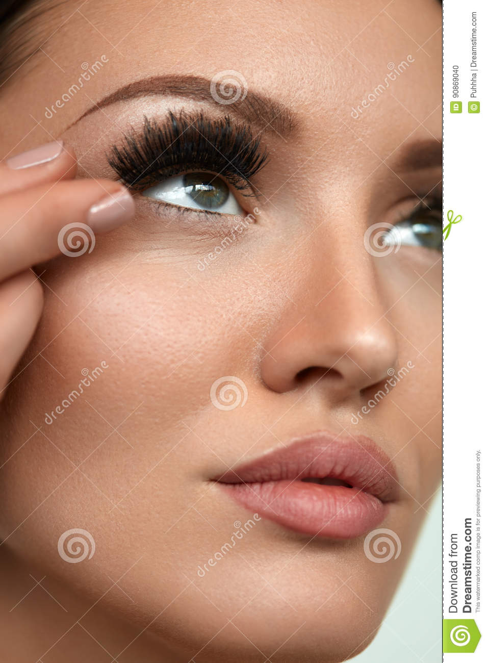 cb9531538d3 Applying False Eyelashes. Long Fake Lashes On Young Woman Eye. Closeup Of Beautiful  Female Model Face With Perfect Smooth Skin And Professional Natural ...