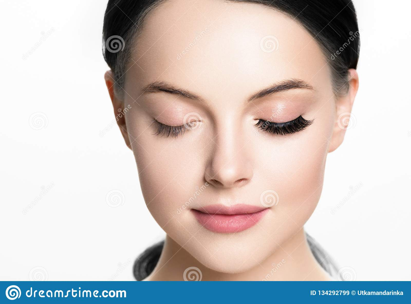 Beautiful woman face with eyelashes lashes extension before and after beauty healthy skin natural makeup closed eyes