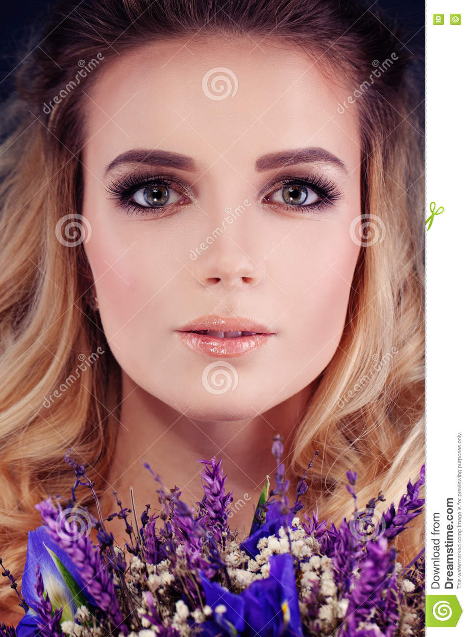 Beautiful Woman with Flowers. Cute Face Closeup