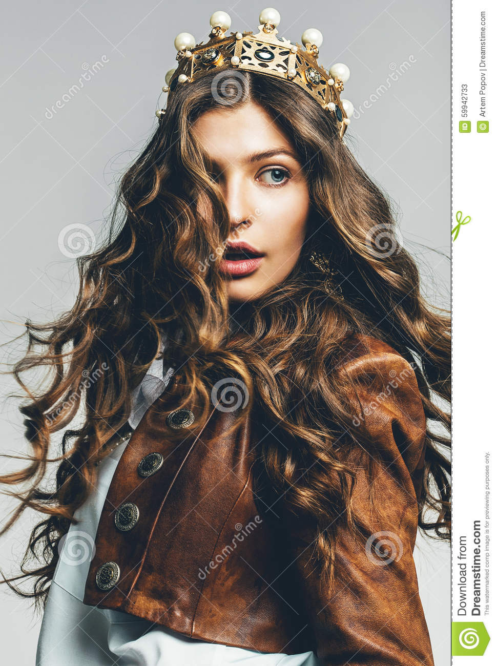 Beautiful woman with flying hair in crown