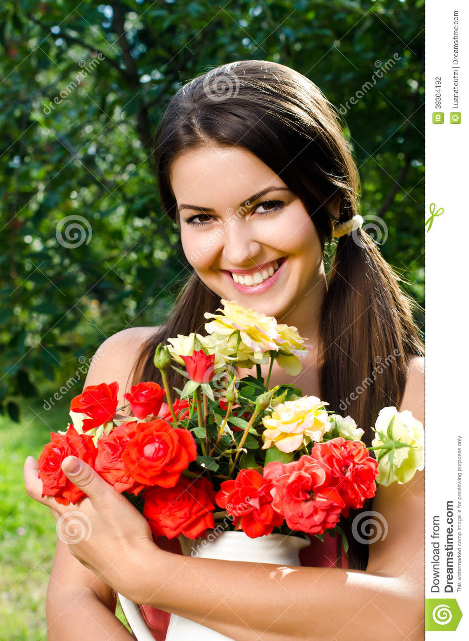 Beautiful woman in the garden with flowers stock photo image beautiful flowers dhlflorist Gallery