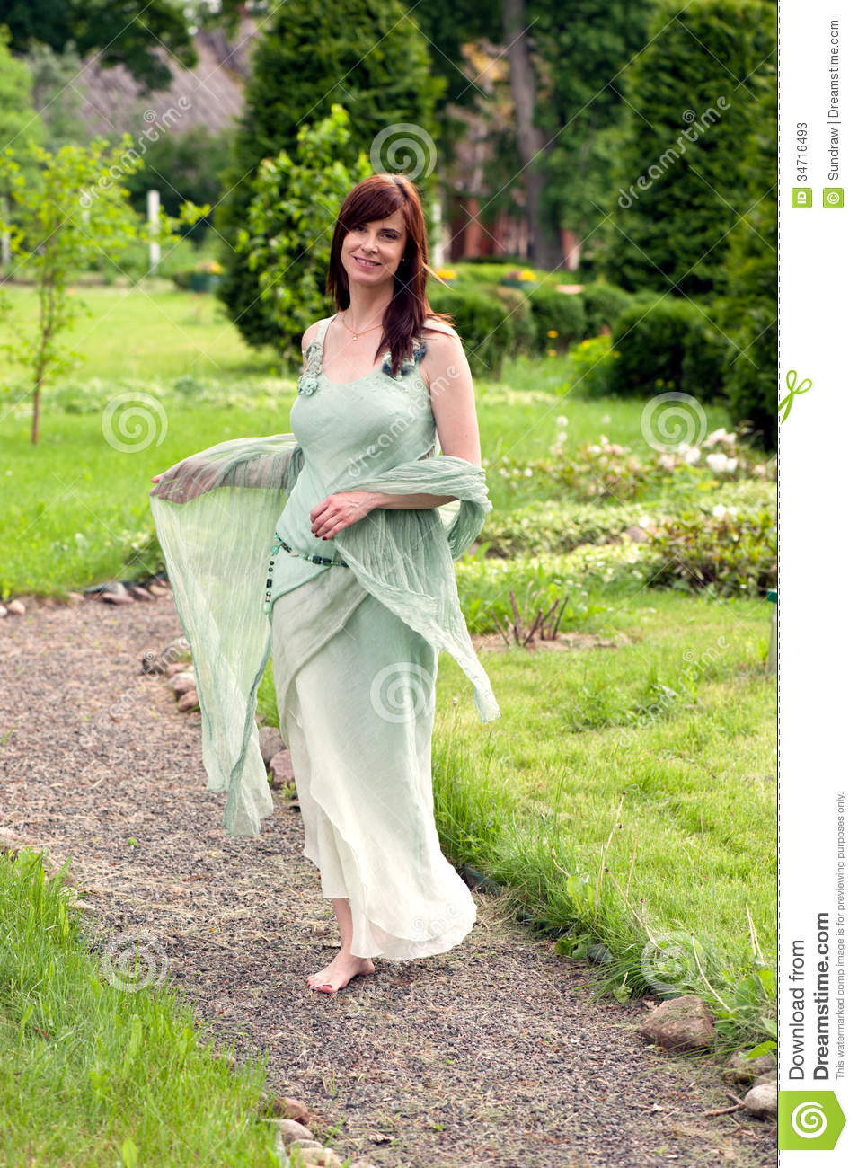 Beautiful Woman In The Garden Stock Photos - Image: 34716493