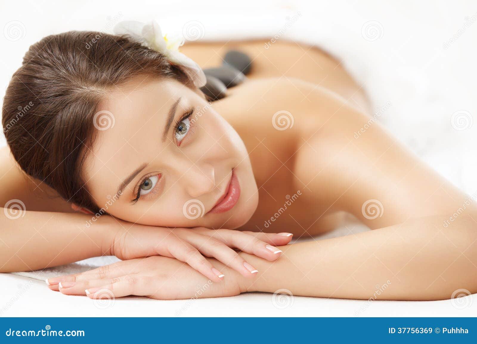 naked women gets ass massage