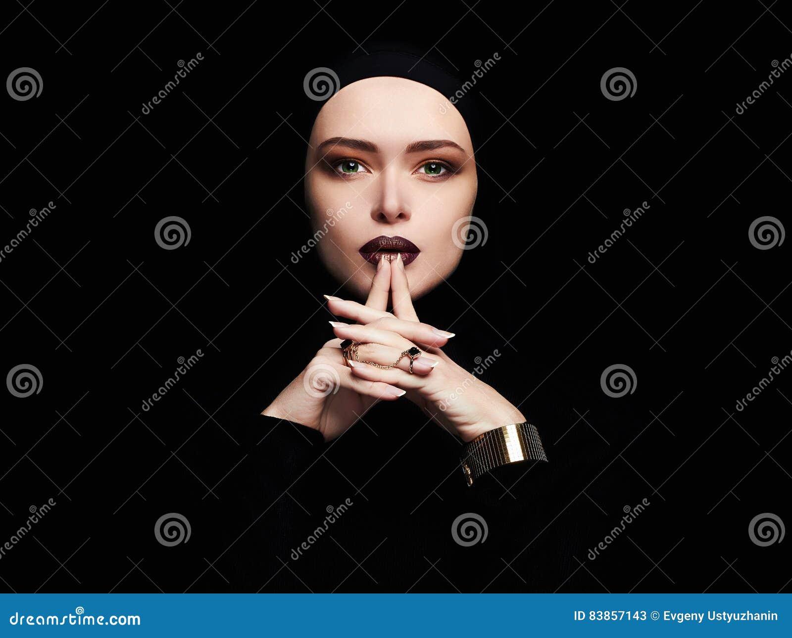 Beautiful woman,gold jewelry.face like a mask