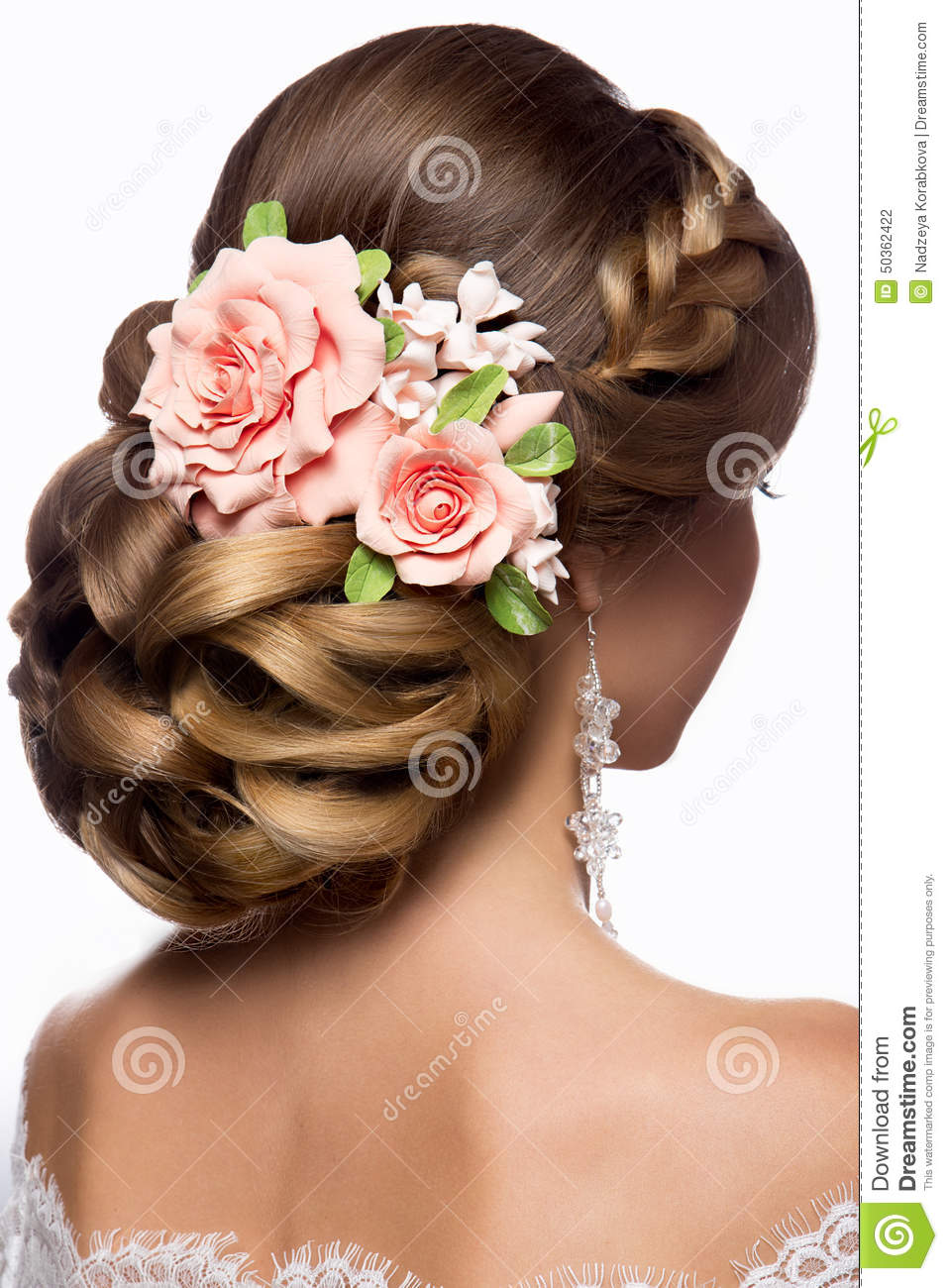 Beautiful woman with gold makeup.Beautiful bride with fashion wedding hairstyle.