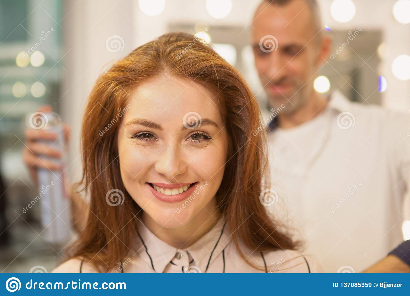 Beautiful woman at hair beauty salon