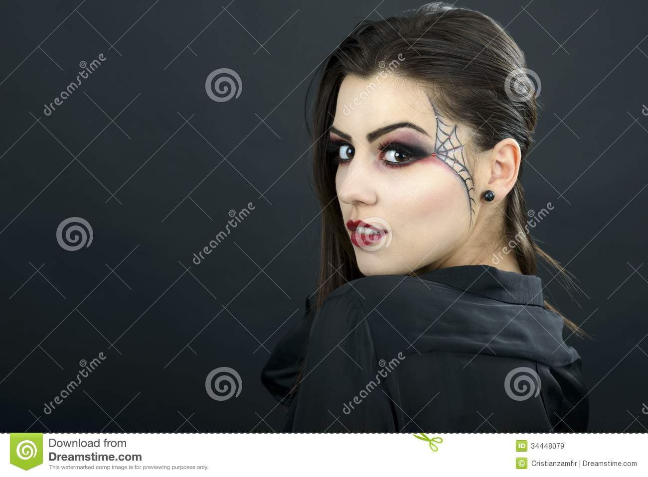 beautiful woman with halloween makeup isolated on black backgrou