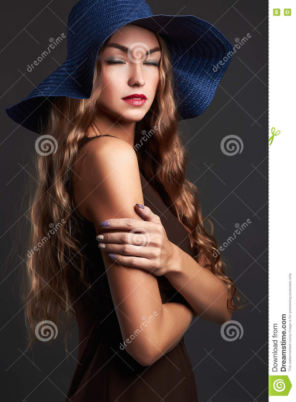 woman in hat. summer fashion beauty model girl with healthy hair