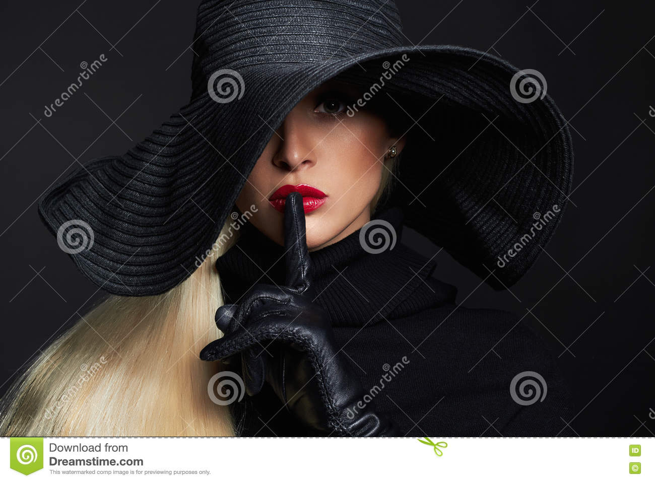 Beautiful woman in hat and leather gloves. Retro fashion model girl.halloween witch