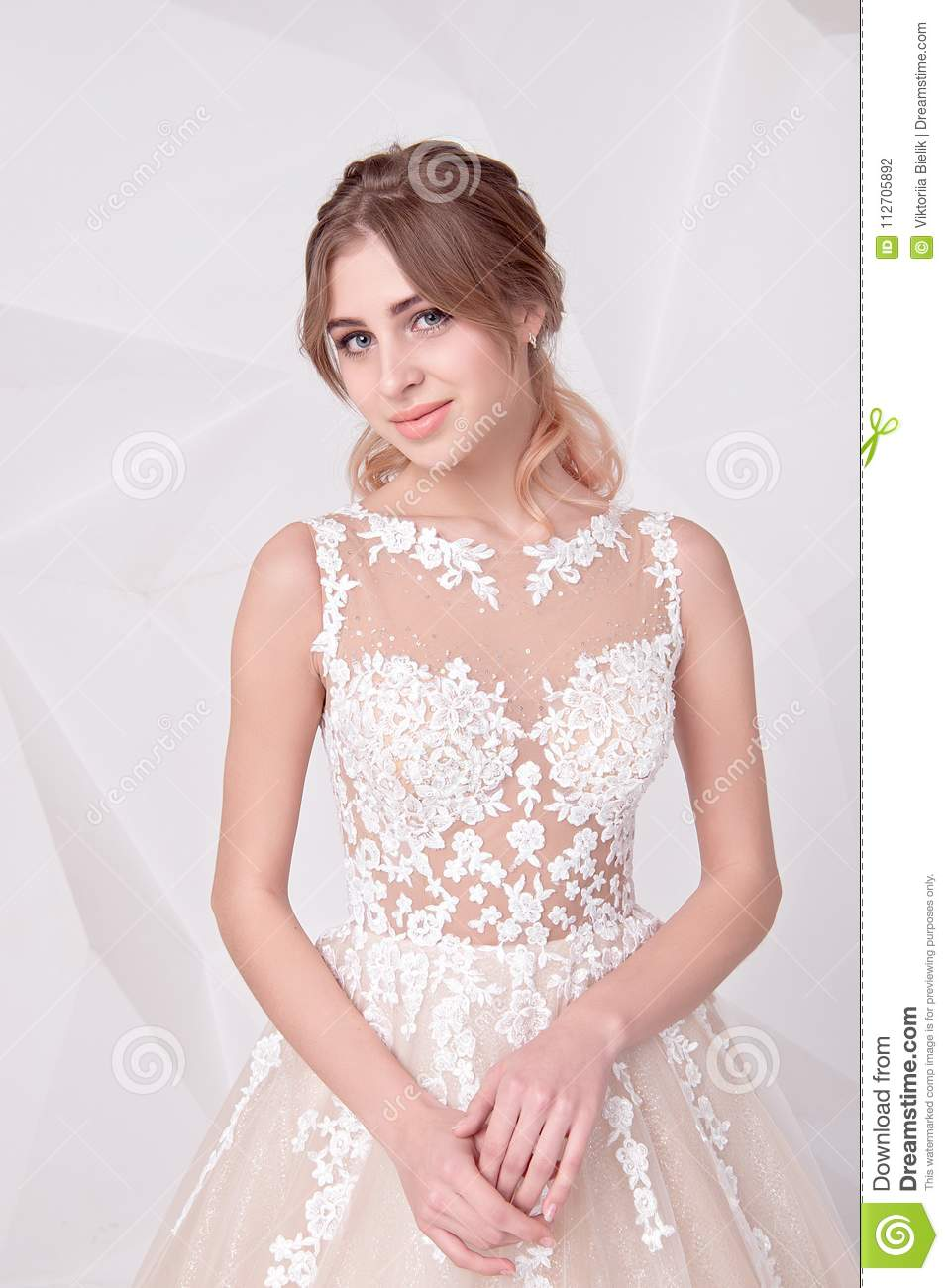 Beautiful Woman Holding A Bouquet Of Flowers Wearing In Luxurious ...