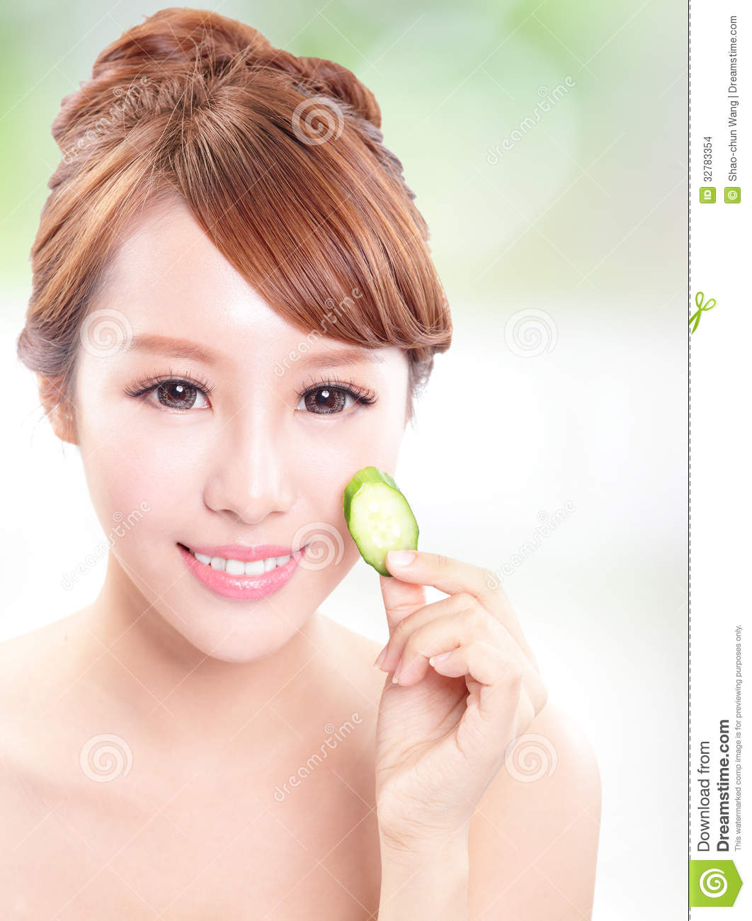 Skin Care Model: Beautiful Woman Holding Cucumber Slices On Face Stock
