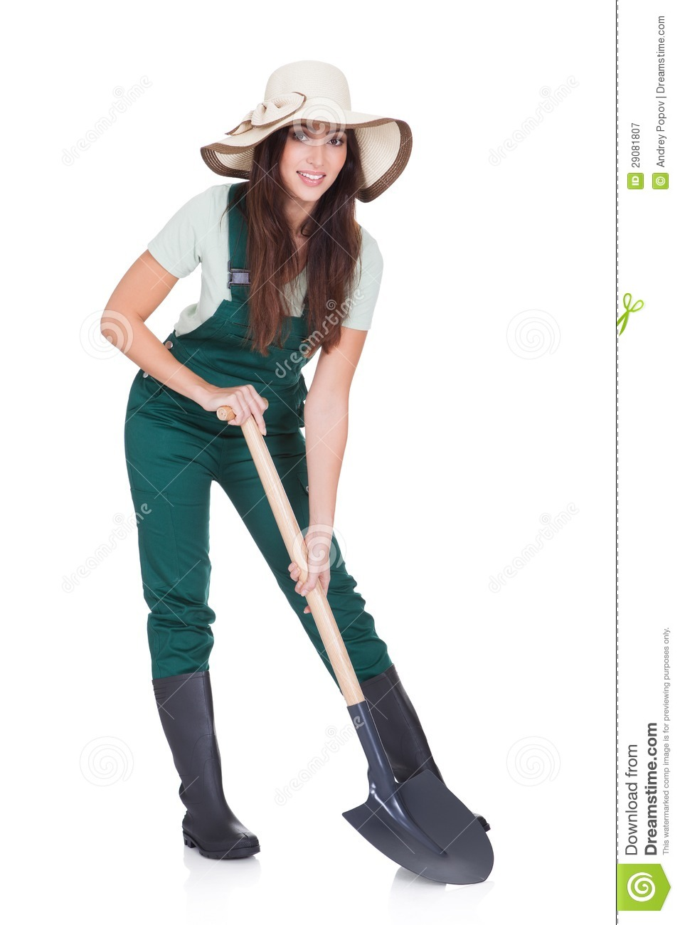 Beautiful Woman Holding Plant And Gardening Shovel Royalty