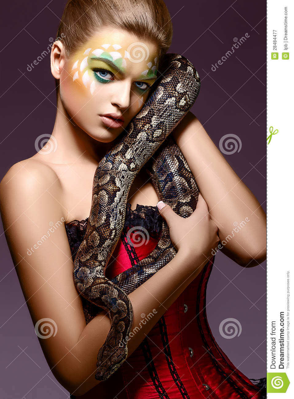 woman holding a snake nude