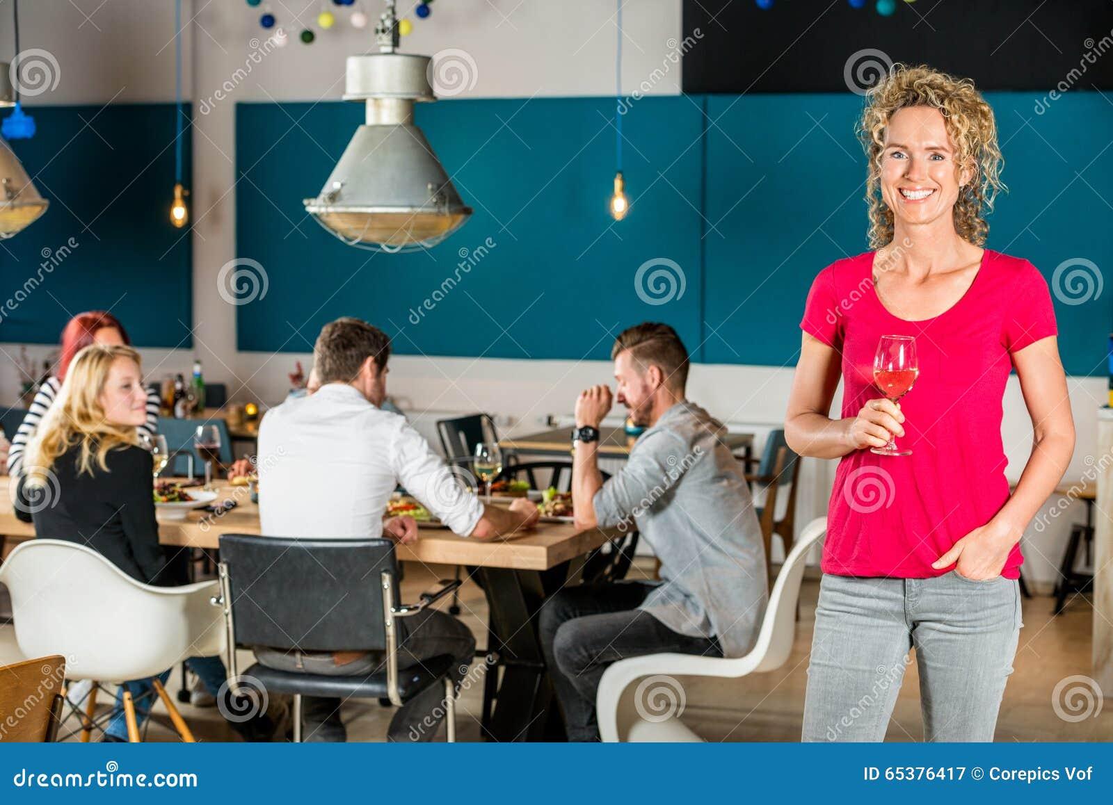 Beautiful Woman Holding Wineglass At Cafe