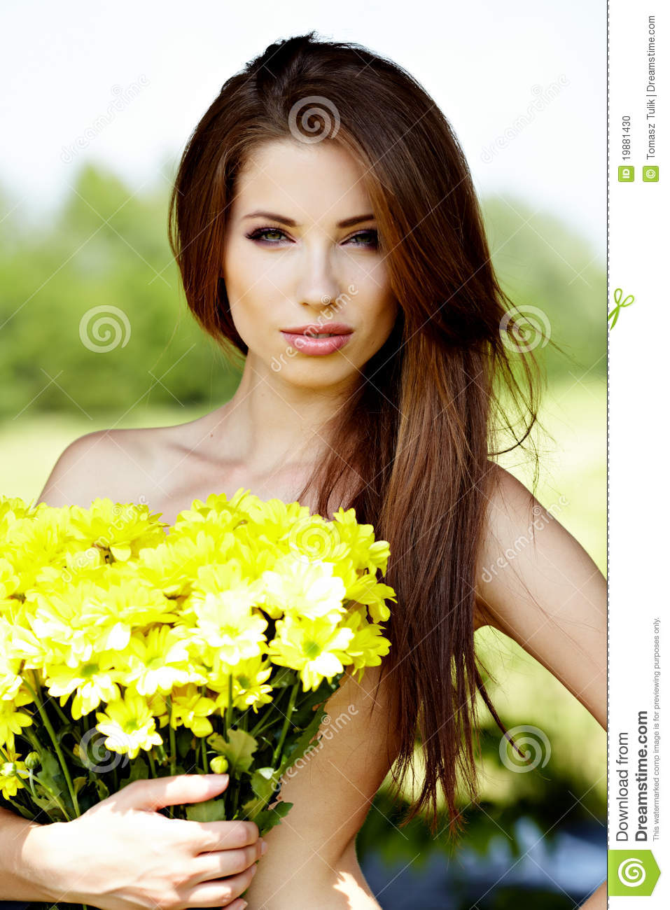 .Beautiful Woman Holding Yellow Flowers Stock Photo ...