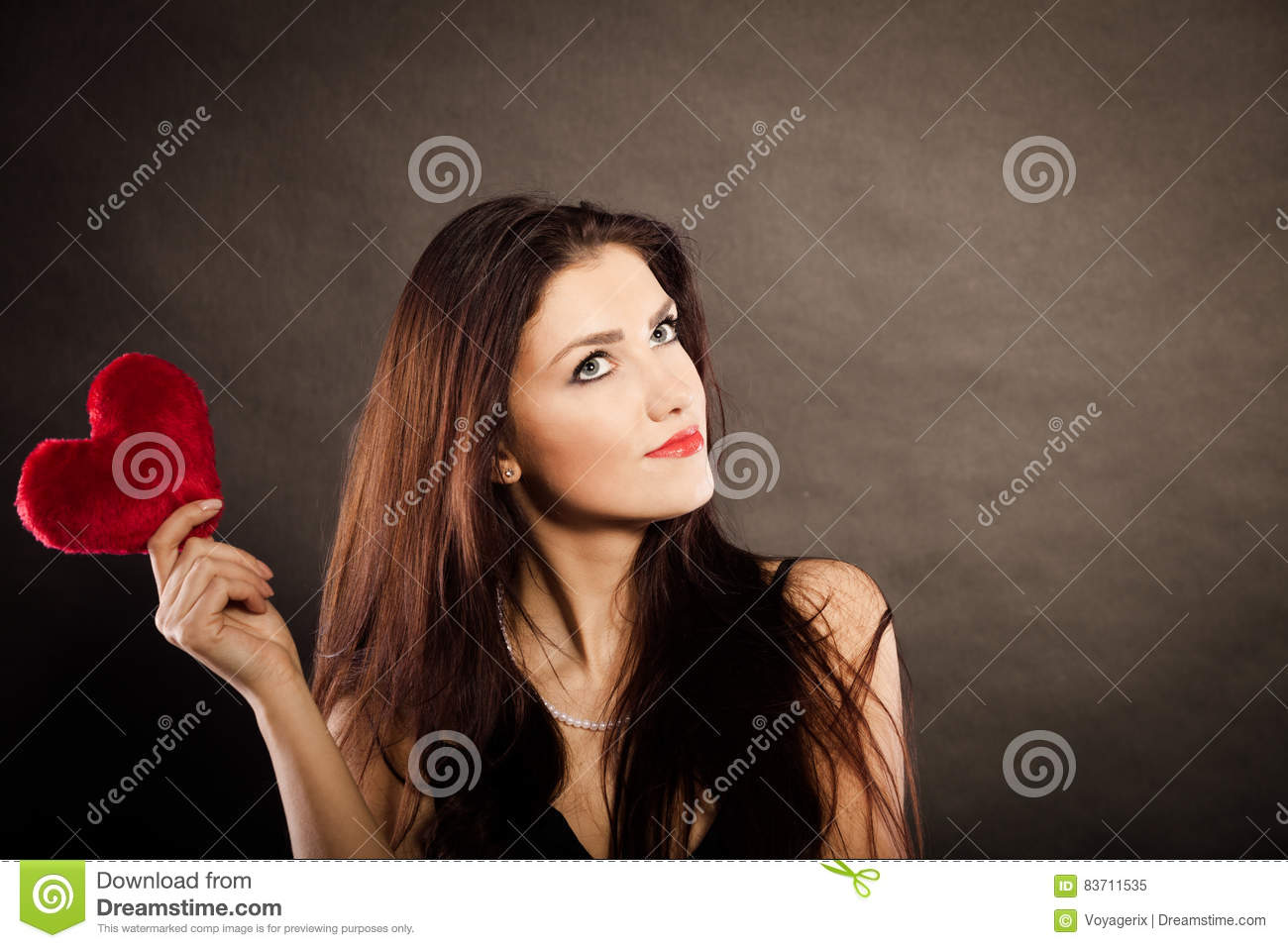 Beautiful Woman Holds Red Heart On Black Stock Photo