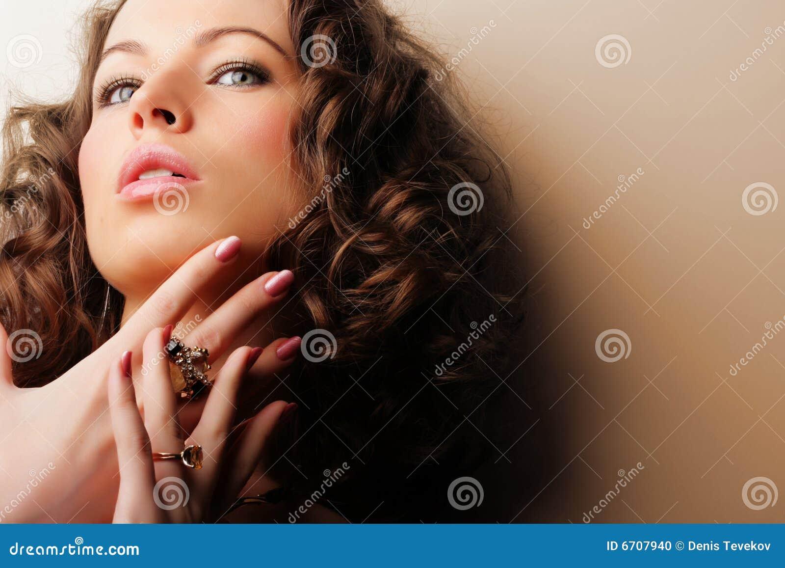 Beautiful woman. Jewelry and Beauty