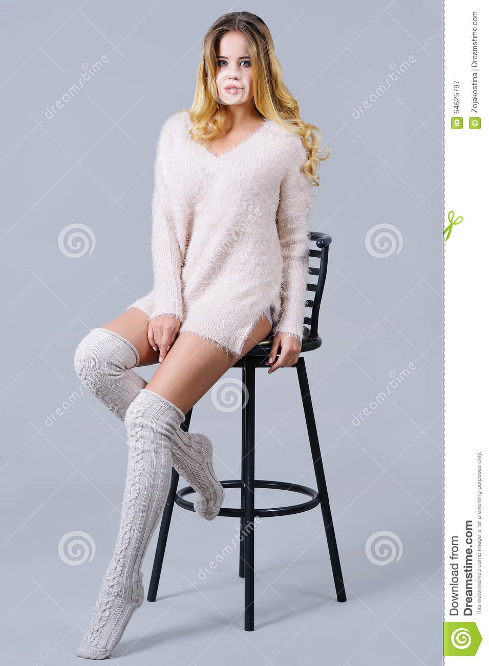 Beautiful Woman In Knitted Knee Socks Sitting On A Bar