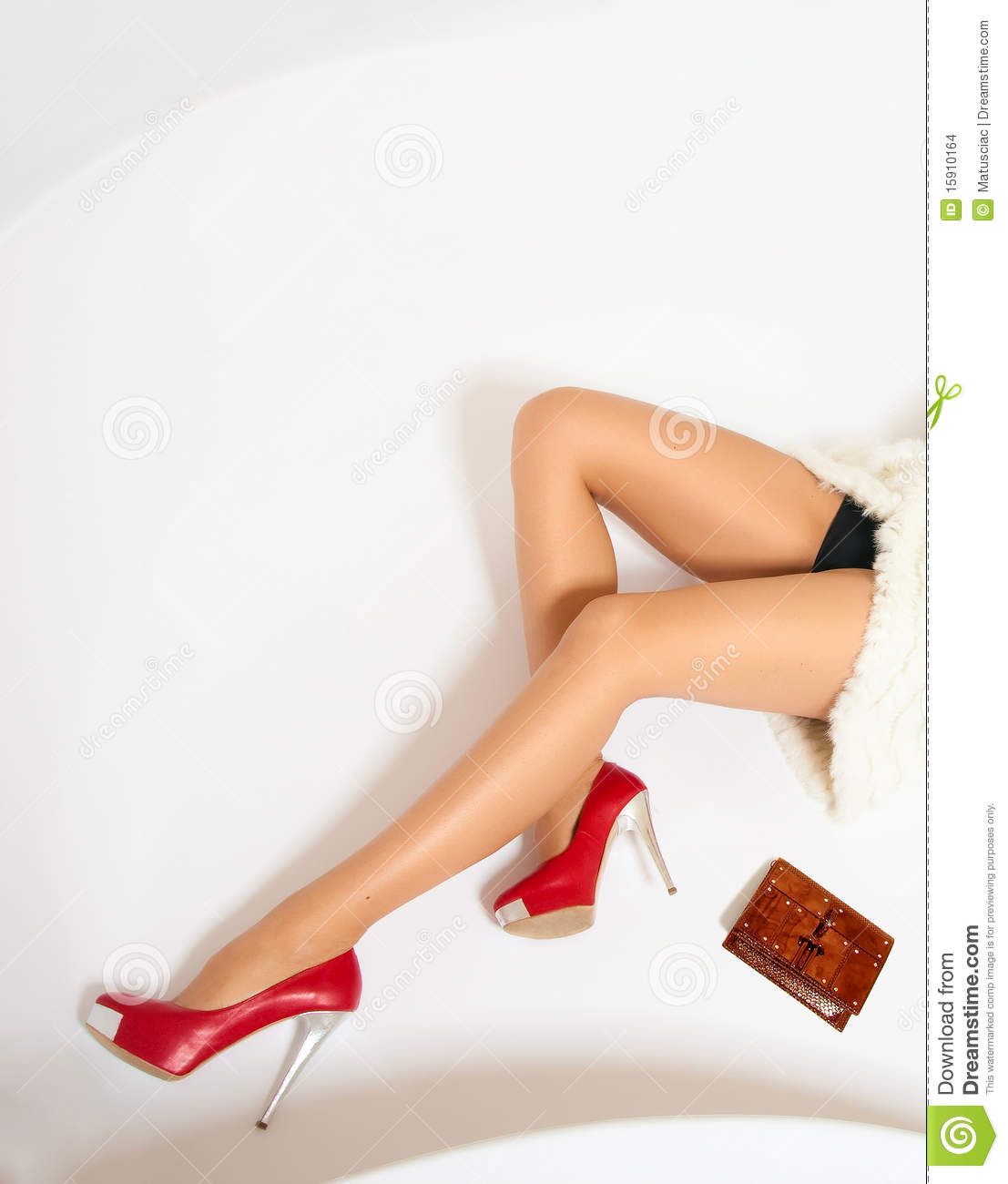 Beautiful woman legs with red high heels
