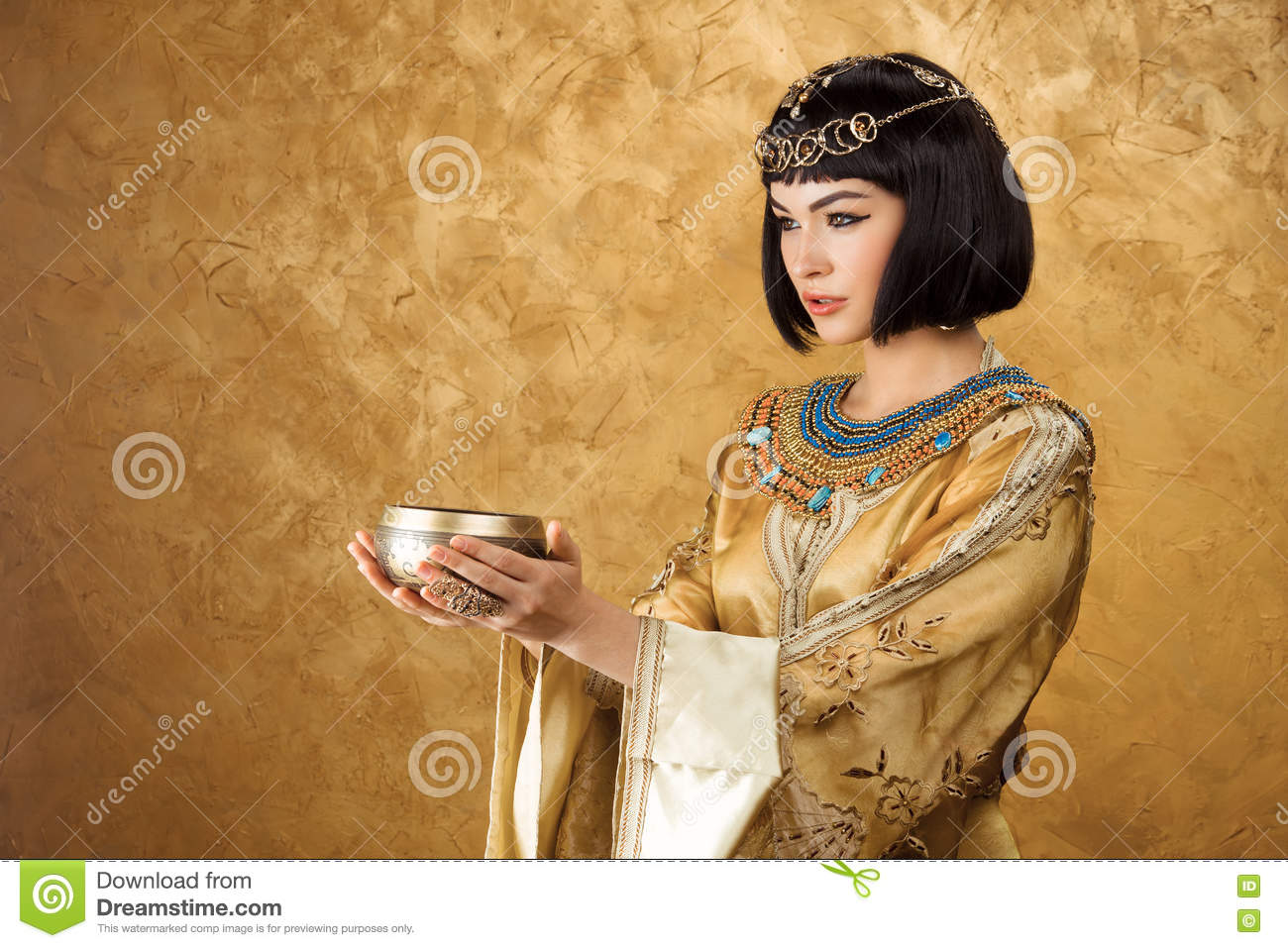 Beautiful Girl Holding Fashion Beauty Magazine Stock Image: Beautiful Woman Like Egyptian Queen Cleopatra With Cup On