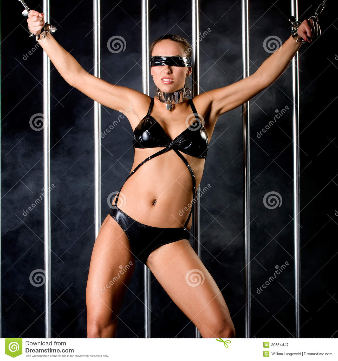 A Very Beautiful And Woman Bound With Steel Handcuffs And Blindfolded In Lingerie In Bondage Style