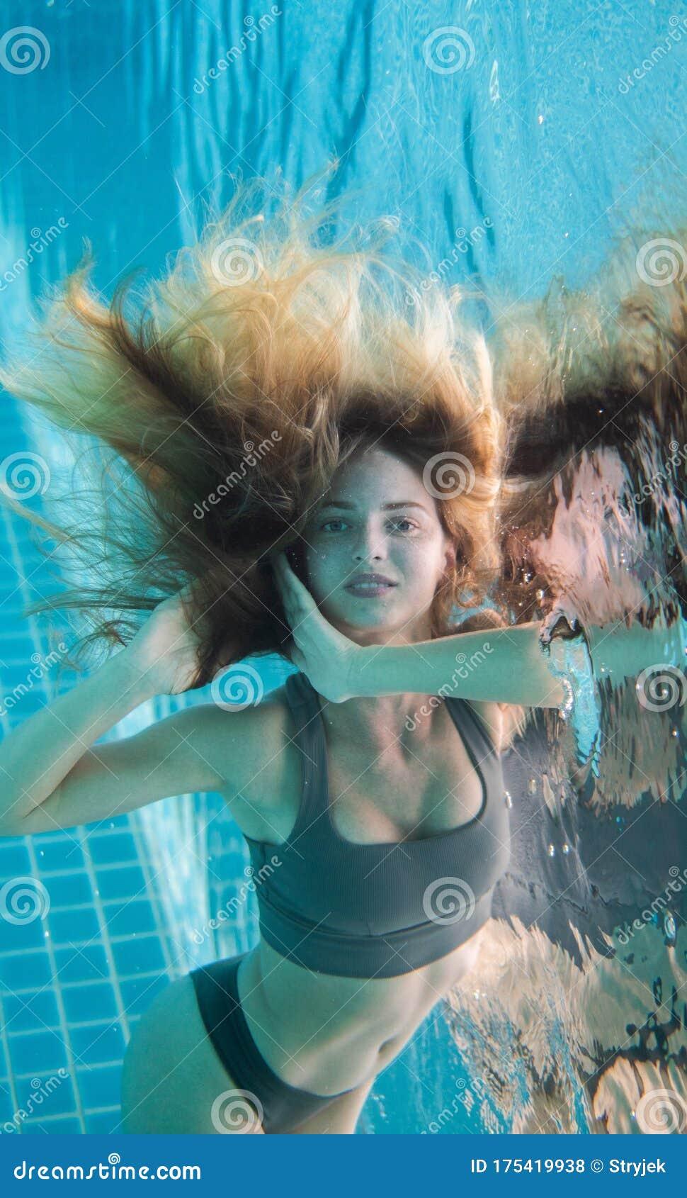 Beautiful Woman Posing Underwater In White Dress Stock