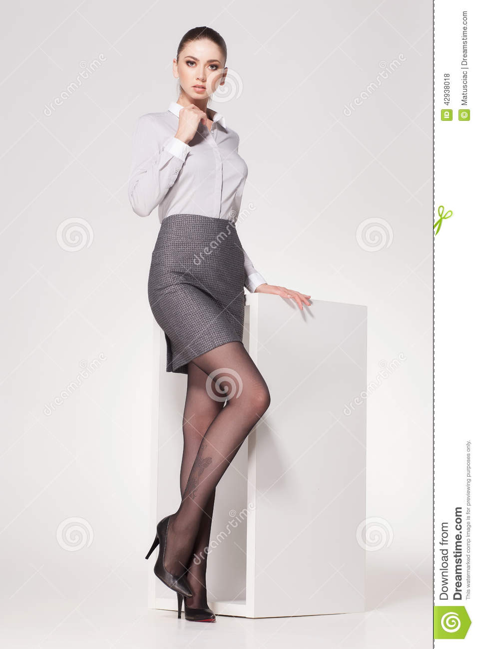 418574f44032e Beautiful Woman With Long Legs Dressed Elegant Posing In The Studio ...