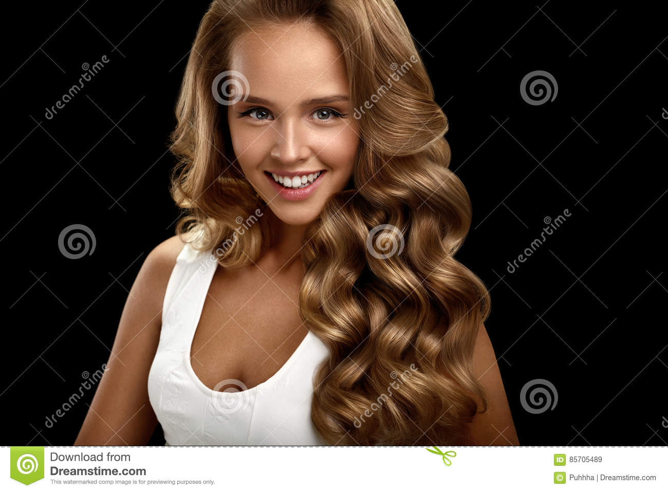 Beautiful Woman With Long Shiny Blonde Wavy Curly Hair