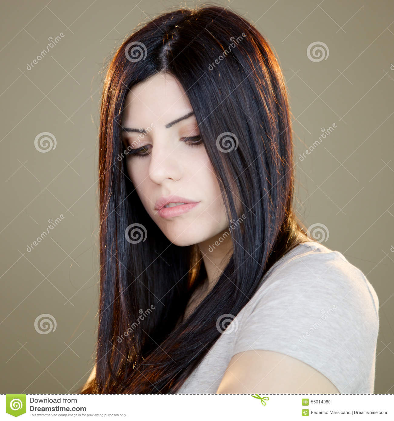 Beautiful woman looking down intense expression