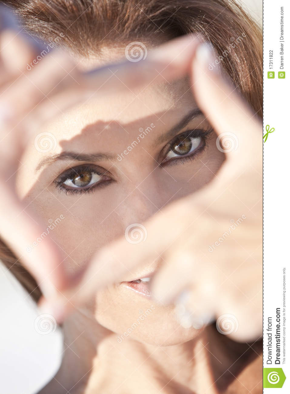 Beautiful Woman Looking Through A Finger Frame