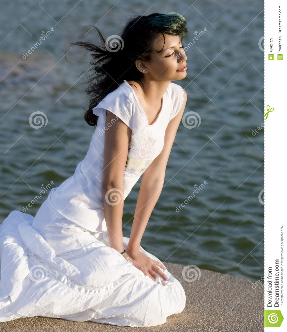 Beautiful Woman Looking Out At Ocean A Stock Image