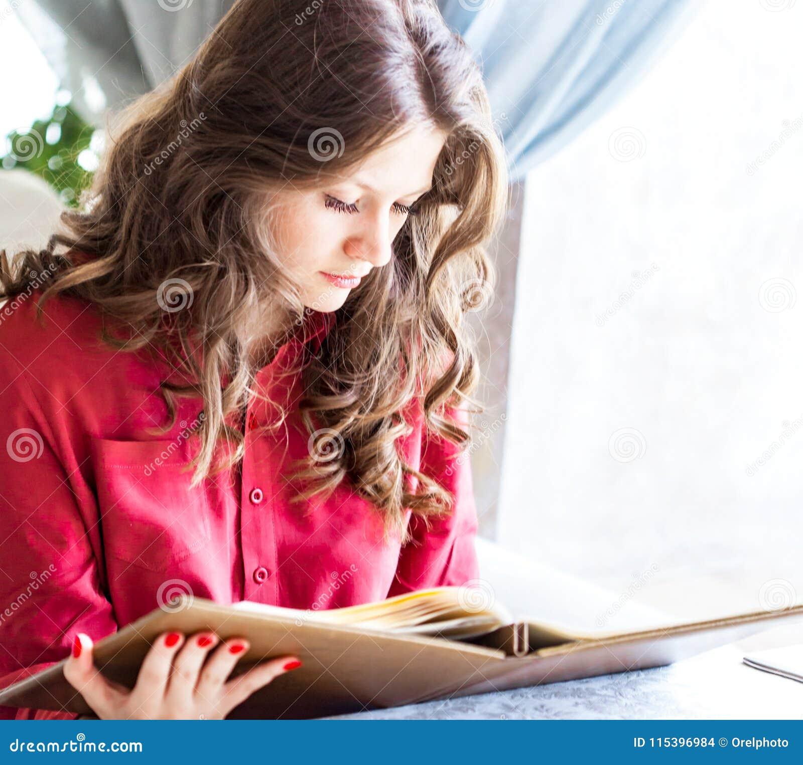 Beautiful Woman Looks On Menu At Expensive Restaurant Stock