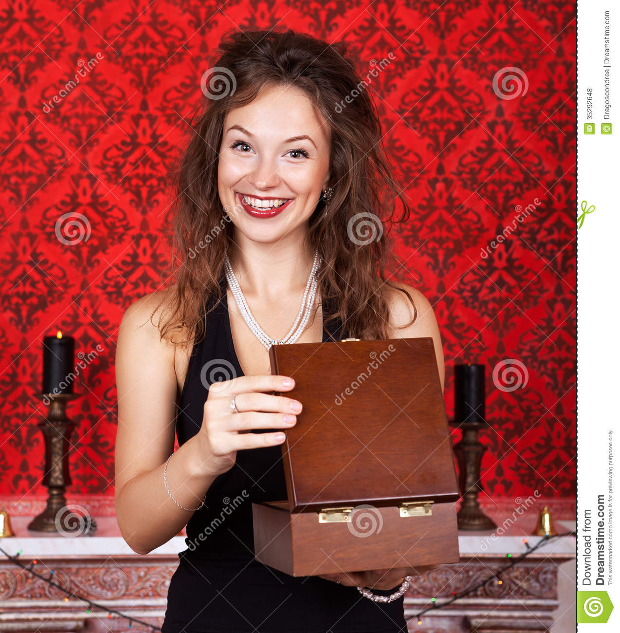 Beautiful woman in luxury interior with a christmas gift for Luxury gift for women