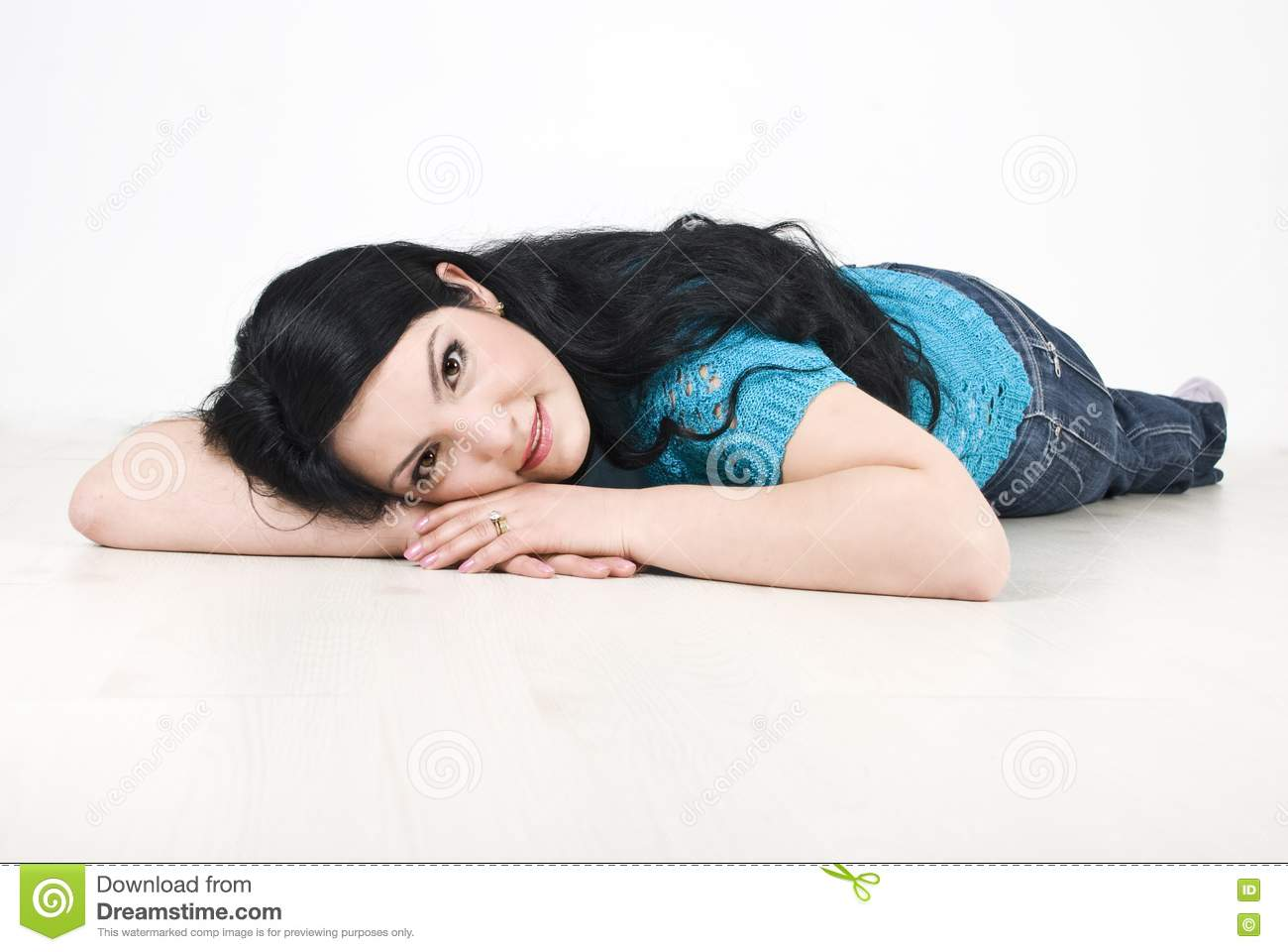Beautiful woman lying down on floor stock photo image for On the floor
