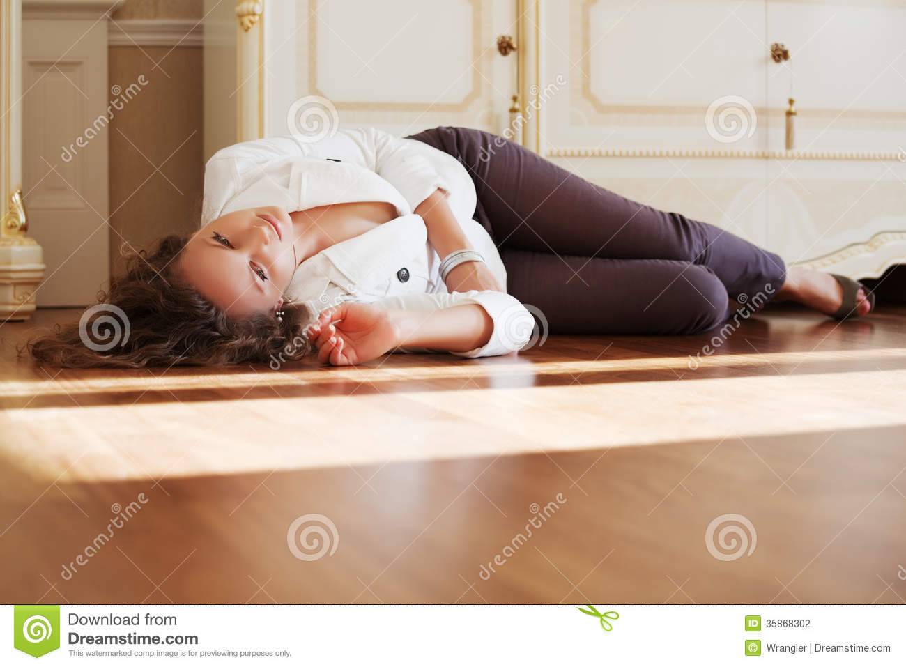 Beautiful Woman Lying On The Floor At Apartment Stock