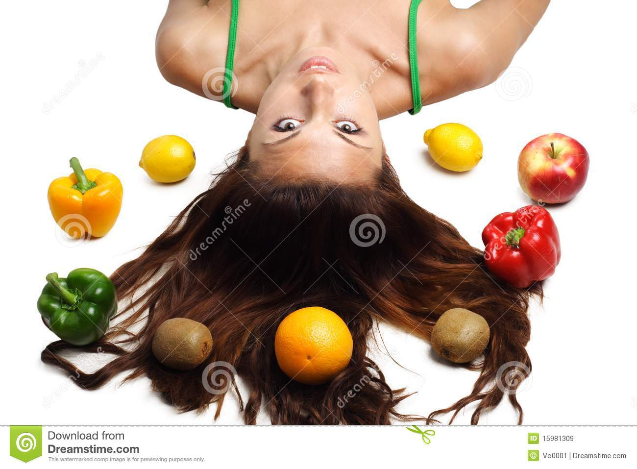 Beautiful woman lying with fruits and hair