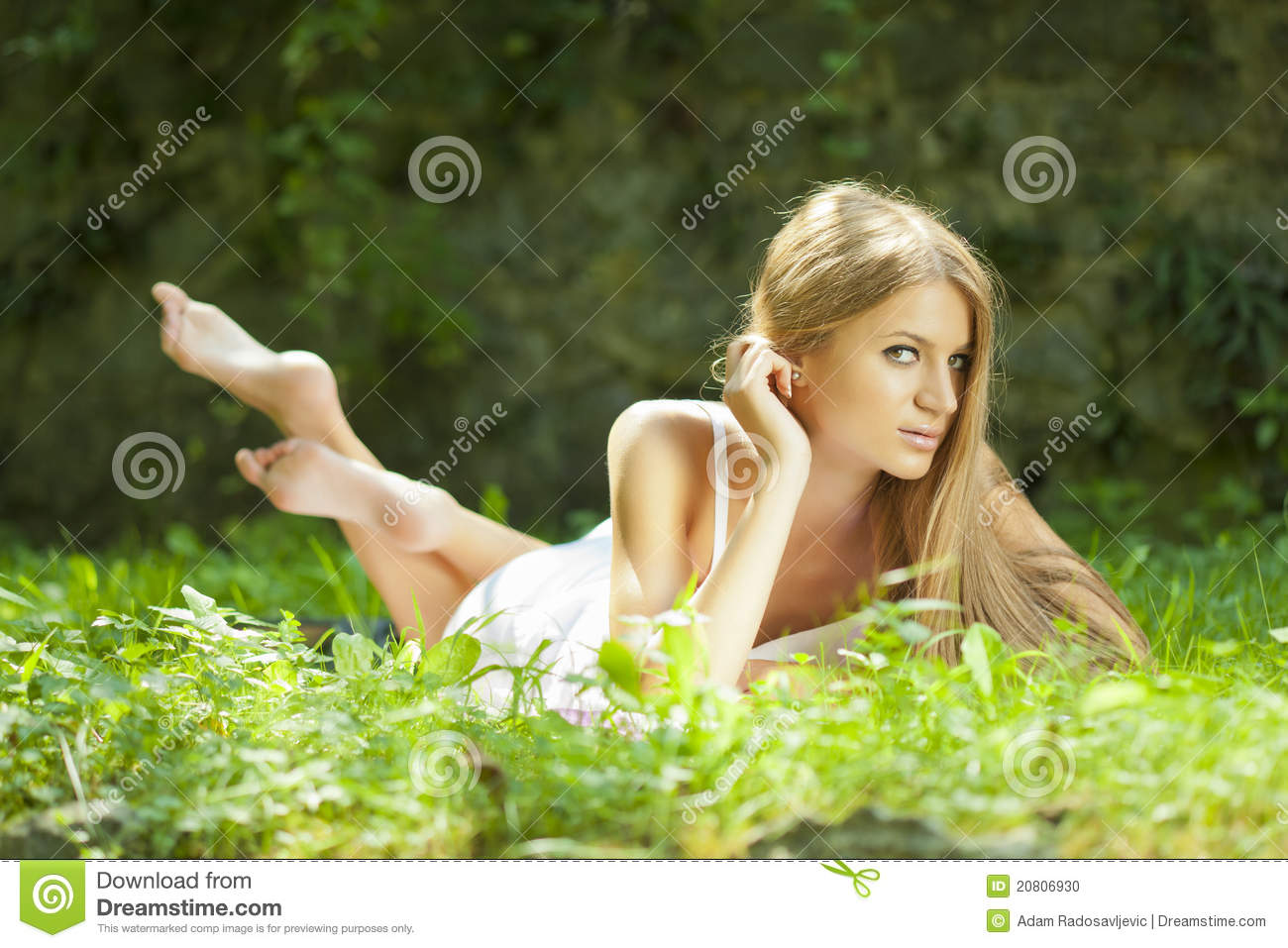 Brunette on grass stock photo. Image of forest, camera