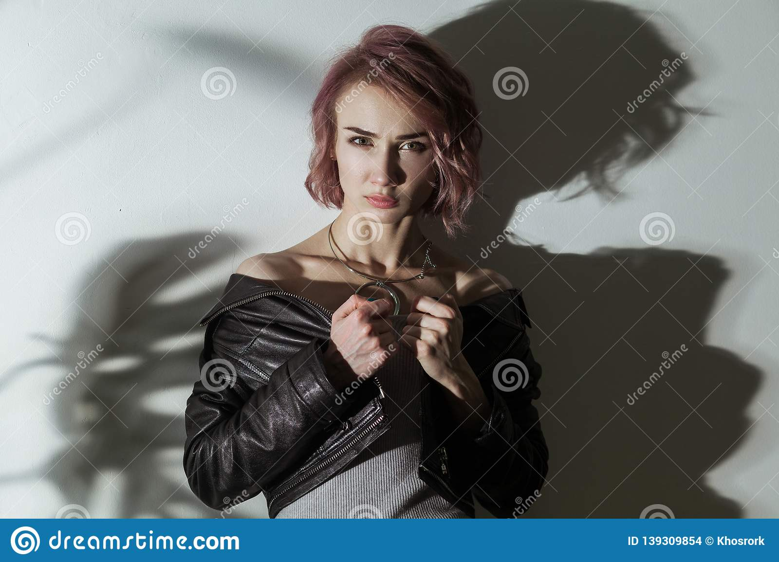 bb54c3ec5fc Beautiful Woman With Makeup And Short Pink Hair In Grey Dress And ...